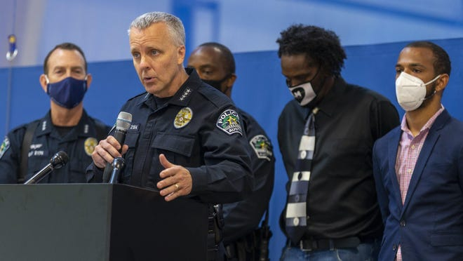 Appearing with officers and representatives of the community organization Just America, Austin Police Chief Brian Manley speaks during a press conference at Boys & Girls Clubs of the Austin Area on June 11. Just America would later call on Manley to resign.