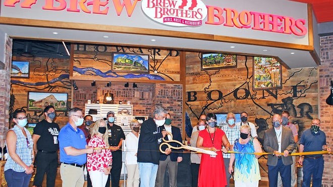 Members of the Boonville Area Chamber of Commerce on Aug. 3 helped Brew Brothers Gregg, Gary, Gene and Glenn Carano cut the ribbon of the sixth location of The Brew Brothers restaurant at Isle of Capri Casino Hotel.