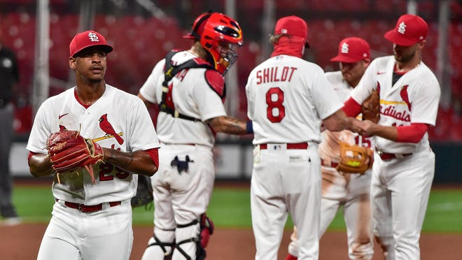 St. Louis Cardinals relief pitcher Alex Reyes (29) walks off the field after he was removed from the game by manager Mike Shildt (8) on Aug. 24 at Busch Stadium in St. Louis.