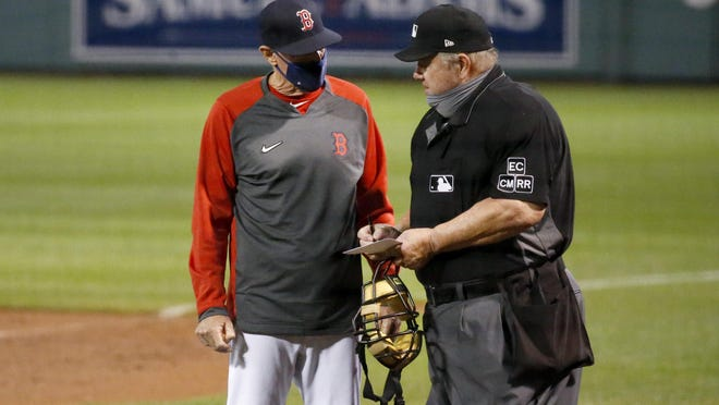 Ron Roenicke said the Red Sox are starting to get used to the new normal brought on by COVID regulations, but wants to see the team do better when it comes to things like wearing masks.