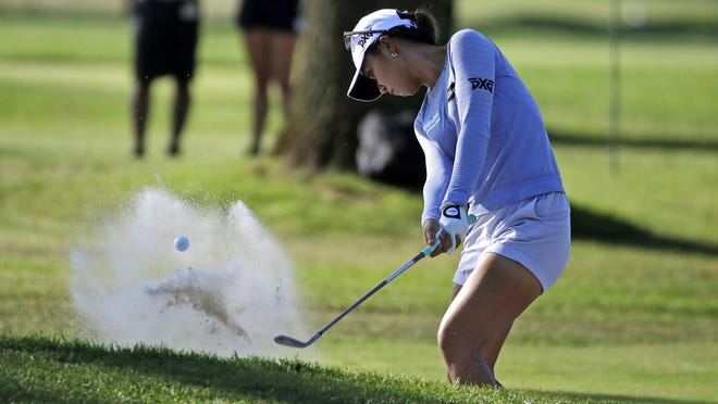 Lydia Ko of New Zealand hits out of a bunker onto the 17th green Saturday during the third round of the Marathon Classic.