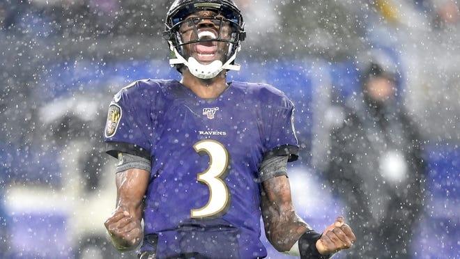 Baltimore Ravens quarterback Robert Griffin III celebrates a touchdown in the second quarter against the Pittsburgh Steelers in Week 17 last season. He got the start in the regular-season finale and led the Ravens to the win.
