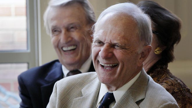 FILE - Former U.S. Senators David Pryor, right, and Dale Bumpers, both D-Ark., laugh at a joke during a meeting Wednesday, Sept. 18, 2013, at the Governor's Mansion in Little Rock, Ark. Arkansas Gov. Asa Hutchinson on Monday, July 13, 2020, said that the state needs to work to lower its number of new daily cases of the coronavirus and that Pryor, a former Arkansas governor and U.S. senator, had been hospitalized with the virus.
