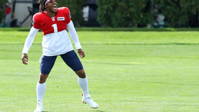 Cam Newton loves to include dance steps while warming up for practice with the Patriots.
