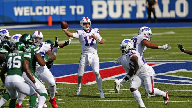 Buffalo Bills quarterback Josh Allen (17) went 33 of 46 for 312 yards with two touchdowns, plus another one rushing in the team's season-opening win over the New York Jets.