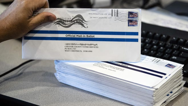 FILE - In this May 28, 2020, file photo, mail-in primary election ballots are processed at the Chester County Voter Services office in West Chester, Pa.