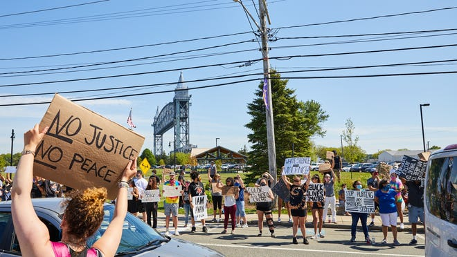 Protesters line Main Street in Buzzards Bay Thursday afternoon for a Black Lives Matter rally calling attention to the death of George Floyd.