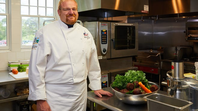 Michael Pillarella, executive chef at the Wianno Club in Osterville, oversees the prep station in the kitchen Friday morning. He has found going back to work difficult because of the demands it places on his wife at home.