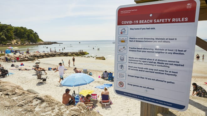 Safety rules related to the coronavirus are posted at Old Silver Beach in Falmouth. Parking restrictions allow beachgoers to maintain distance from each other.
