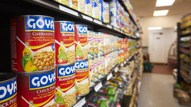 Goya products line the shelves at GOL Supermarket in Hyannis. The store's owner says he does not plan to stop selling Goya products despite controversy over comments made by the company's CEO in support of Donald Trump.