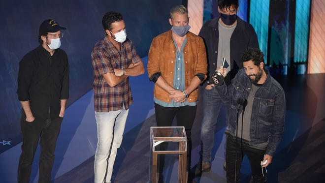Old Dominion accepts the group of the year award during the 55th annual Academy of Country Music Awards at the Grand Ole Opry House on Wednesday, Sept. 16, 2020, in Nashville, Tenn.