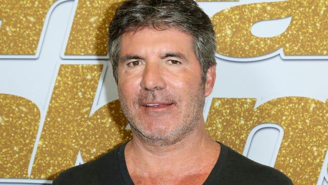 TV personality Simon Cowell broke his back Saturday.