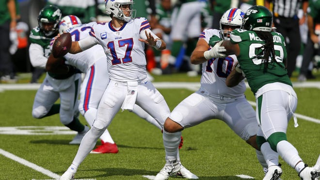 Buffalo Bills quarterback Josh Allen throws a pass during the second half against the New York Jets in Week 1. He combined a great passing game with his team-leading rushing  yardage to have an explosive fantasy performance. He has an even easier matchup against the Miami Dolphins this week.