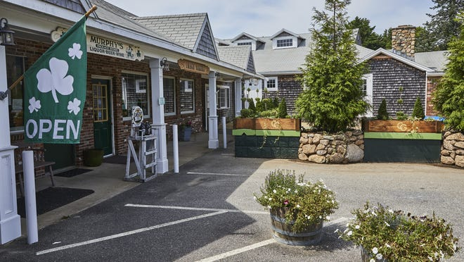 An attorney representing Murphy's Package Store told a Barnstable Superior Court judge on Thursday that the store has suffered financial harm because of the loss of parking spaces in front of the store due to Chapoquoit Grill's outdoor patio.