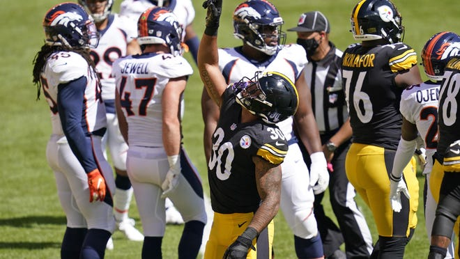 Pittsburgh Steelers running back James Conner (30) celebrates his touchdown during the first half of an NFL football game against the Denver Broncos, Sunday, Sept. 20, 2020, in Pittsburgh.