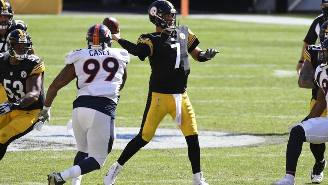 Pittsburgh Steelers quarterback Ben Roethlisberger (7) gets off a pass under pressure by Denver Broncos defensive end Jurrell Casey (99) during the second half of an NFL football game in Pittsburgh, Sunday, Sept. 20, 2020.