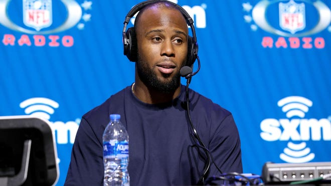 Patriots running back James White talks to the media at Super Bowl LIV on Jan. 31. Teammates and friends around the NFL have rallied to support him as he mourns the loss of his father in a car crash.