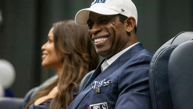 Deion Sanders smiles as he is introduced as Jackson State's football coach on Monday.