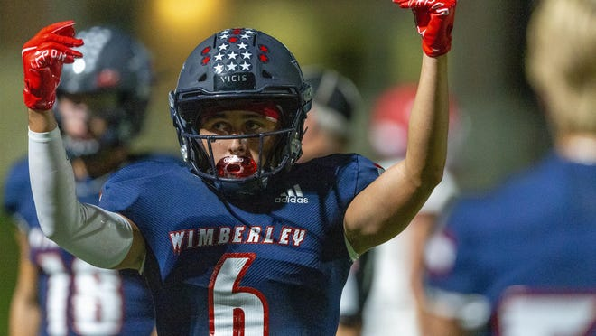 Wimberley wide receiver Jaxon Watts celebrates a touchdown against Fredericksburg during the Texans' win Friday. The Texans handed the Billies their first loss and remain No. 3 in the Statesman's Class 4A and below poll.