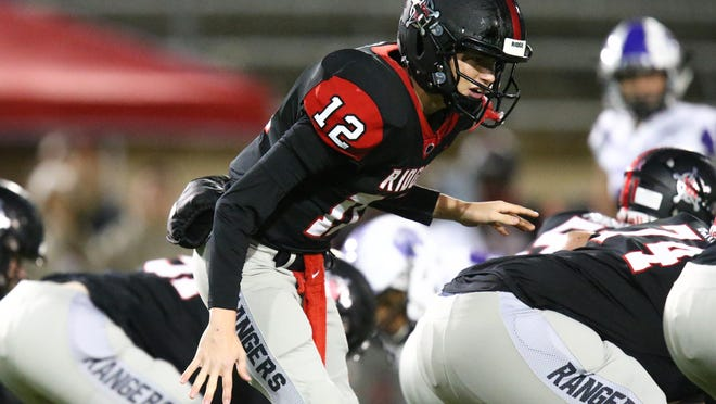 Vista Ridge quarterback Kyle Brown, barking out a play during a game against Cedar Ridge last season, is back after earning Class 6A All-State honors last season.