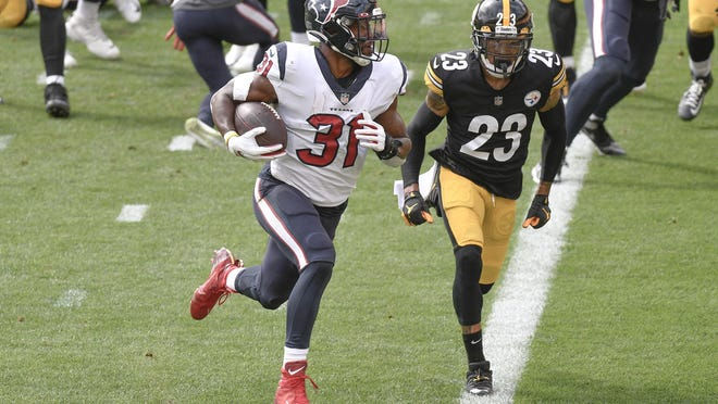 Houston Texans running back David Johnson gets past Pittsburgh Steelers cornerback Joe Haden to score a touchdown in the 28-21 loss Sunday. Since rushing for 77 yards in the season-opener, Johnson has totaled only 57 rushing yards over the past two games.