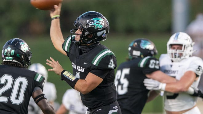 Cedar Park quarterback Ryder Hernandez finished 21-of-31 for 343 yards and four scoring tosses to four different receivers in the Timberwolves' 28-14 win over Cedar Ridge on Friday.