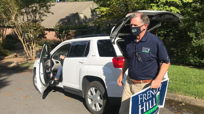U.S. Rep. French Hill delivers campaign signs at a home in Little Rock, Ark., on Aug. 28, 2020. Hill, a Republican, is being challenged by Democratic state Sen. Joyce Elliott in the November election.