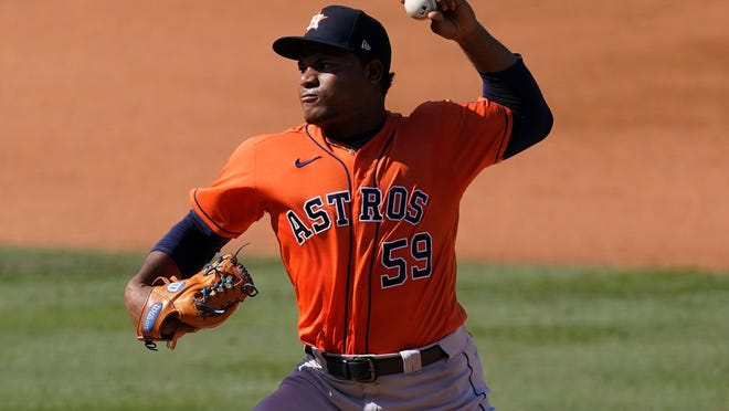 Astros left-hander Framber Valdez delivers Tuesday against the Athletics during the fourth inning of Game 2 of an American League Division Series in Los Angeles.