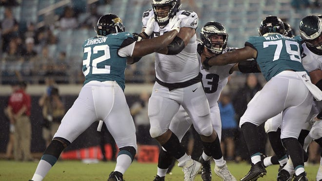 Philadelphia Eagles offensive tackle Jordan Mailata, center, a former rugby player from Australia, is shown against the Jacksonville Jaguars in 2019. Mailata fared well in his first career start protecting Carson Wentz's blind side last week in Philadelphia's 25-20 win at San Francisco.