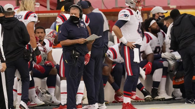 Patriots head coach Bill Belichick and quarterback Jarrett Stidham (4) watch from the sideline during the game against the Chiefs Monday night in Kansas City.