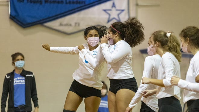 Anastacia Ortega, left, and KK Ruiz of Ann Richards are fired up as they take the court against McCallum on Friday. The Stars won the match in three sets to keep them tied with Anderson in District 17-5A.