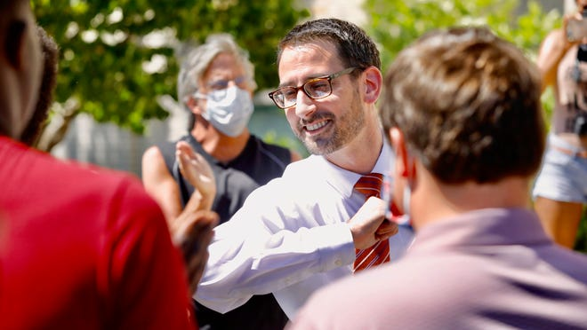 Mayor Tom McNamara greets protesters outside of City Hall on Monday, June 8, 2020, in Rockford. The group is demanding police in the city be equipped with body cameras and funding be redirected toward mental health interventions and training.