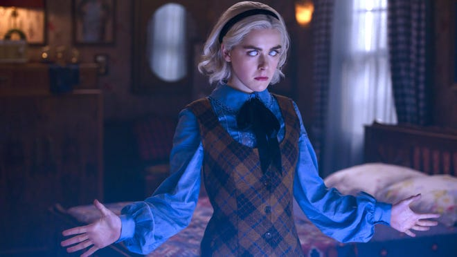 """Kiernan Shipka stars as the title role in """"The Chilling Adventures of Sabrina,"""" a darker version of """"Sabrina the Teenage Witch"""" that aired in the '90s."""