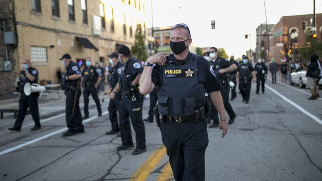 Police pushed protesters north along Madison Street toward Jefferson Street bridge. At least three people were arrested during protests at City Market and outside of CJs Public House on Friday, Sept. 4, 2020, in Rockford.
