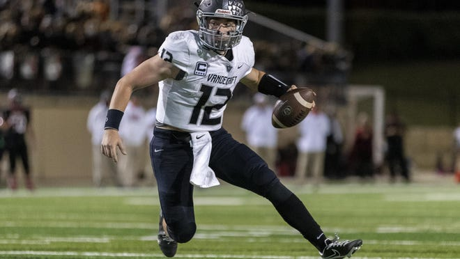 Vandegrift quarterback Ryan Back looks for the outside edge in the Vipers' 40-14 win over Vista Ridge Friday at Gupton Stadium.