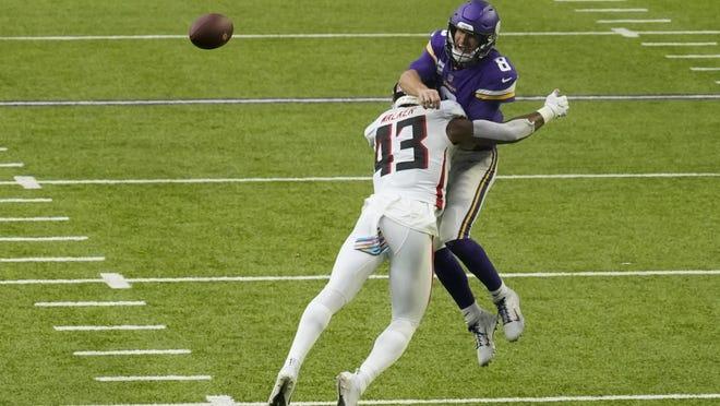 Atlanta Falcons linebacker Mykal Walker (43) hits Minnesota Vikings quarterback Kirk Cousins (8) during the first half of an NFL football game, Sunday, Oct. 18, 2020, in Minneapolis.