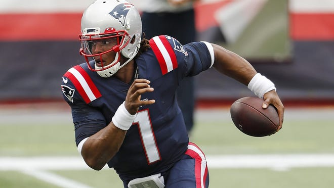 New England Patriots quarterback Cam Newton runs against the Las Vegas Raiders during an NFL football game at Gillette Stadium, Sunday, Sept. 27, 2020 in Foxborough, Mass.