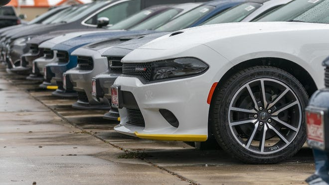 Vehicles are displayed at Nyle Maxwell Supercenter in north Austin on Sept., 17. Austin-area auto sales showed signs of rebounding in September.