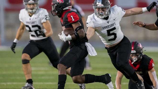 Vandegrift senior linebacker Austin Skoglund, right, closing in on Vista Ridge receiver Emon Allen during Friday's 40-14 victory, finished with 10 tackles and caught a TD pass, earning the American-Statesman player of the week award.