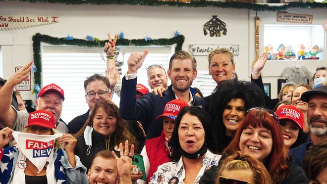Restaurant patrons at Ryan's Place in Epping pose for a group photo with Eric Trump on Monday, during a campaign stop to the popular restaurant.