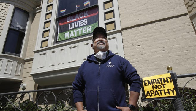 "FILE - In this June 14, 2020, file photo, James Juanillo poses outside of his home in San Francisco. Fed up with white people calling 911 about people of color selling water bottles, barbecuing or otherwise going about with life, San Francisco Board of Supervisors will vote Tuesday, Oct. 20, 2020, on the Caution Against Racial and Exploitative Non-Emergencies Act, also known as the CAREN legislation, a nod to a widespread meme using the name ""Karen"" to describe a specific type of white, middle-aged woman, who exhibits behaviors that stem from privilege such as using the police to target people of color."