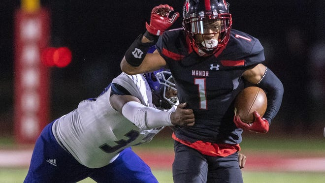 Manor wide receiver/running back Che Nwabuko, escaping a tackle by LBJ linebacker Omarion Neal earlier this month, is a game-changing player on offense and special teams for the Mustangs.