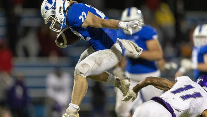 Lampasas running back Jack Jerome, leaping over an LBJ defensive back, scored a pair of touchdowns and rushed for 117 yards in the district showdown.