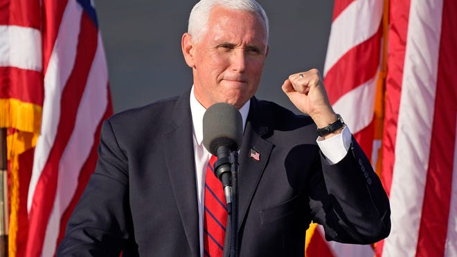 Vice President Mike Pence gestures as he speaks at a campaign rally at Allegheny County Airport in West Mifflin, Pa., on Friday.