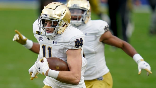 Notre Dame wide receiver Ben Skowronek, left, heads to the end zone as teammate Avery Davis (3) cheers him on after making a catch against Pittsburgh during the first half.