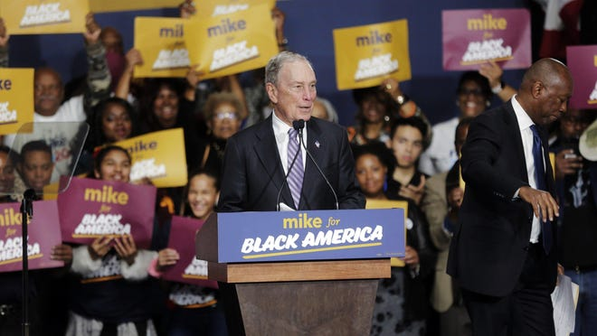 Democratic presidential candidate and former New York City Mayor Michael Bloomberg speaks during a campaign rally at the Buffalo Soldier Museum in Houston on Feb. 13. Houston Mayor Sylvester Turner stands at right.