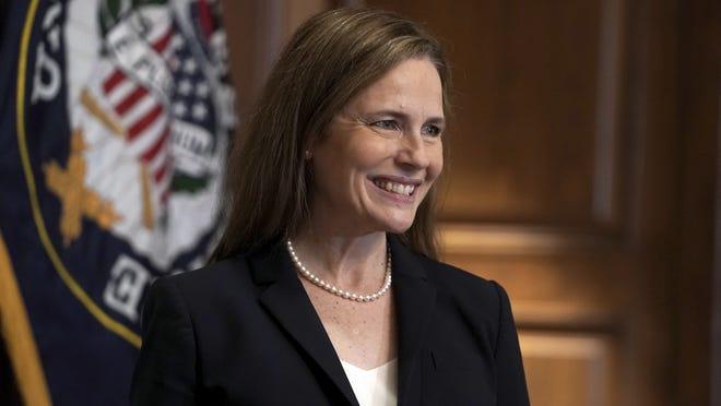 Supreme Court nominee Amy Coney Barrett, meets with Sen. Martha McSally, R-Ariz., Wednesday, Oct. 21, 2020, on Capitol Hill in Washington.
