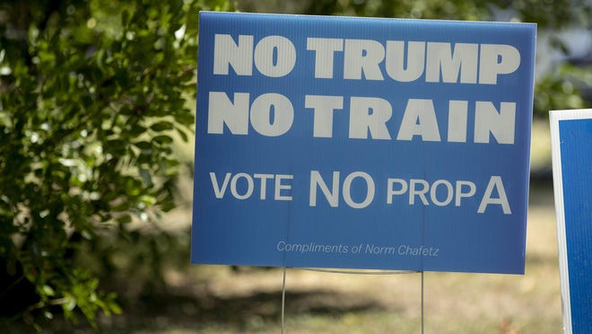 An anti-Proposition A sign sits in an Austin homeowner's yard on Oct. 9.