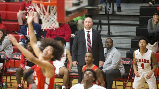 The area's high school sports teams, like the East boys basketball team and head coach Roy Sackmaster, pictured, are gearing up for their seasons.