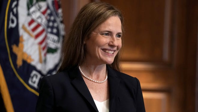Supreme Court nominee Amy Coney Barrett, meets with Sen. Martha McSally, R-Ariz., Wednesday, Oct. 21, 2020, on Capitol Hill in Washington.